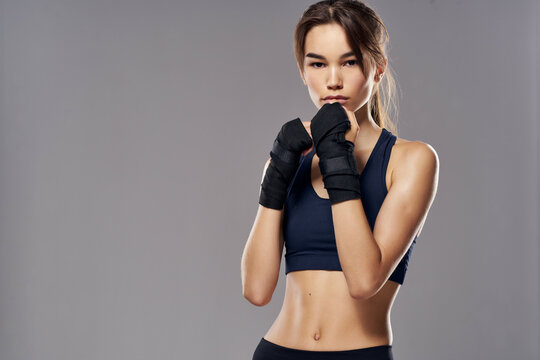 athletic woman boxing workout exercises fitness posing dark background
