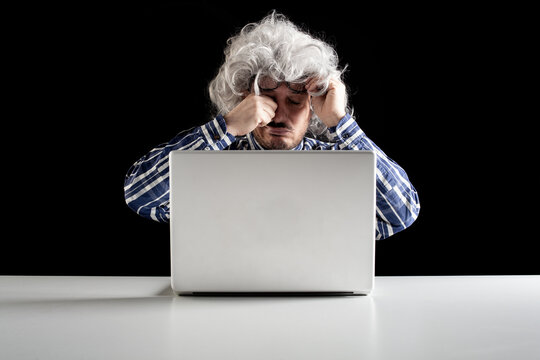 Portrait of a senior man rubbing his tired eyes