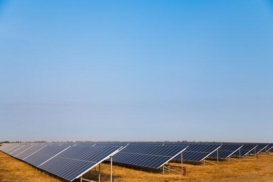 Blue solar panels with the sunny sky