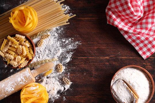 flour food background fresh pasta on wooden background
