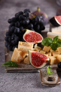 cheese board with grapes and figs