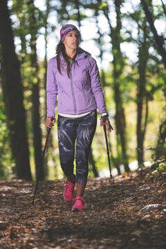 Sporty girl practicing nordic walking