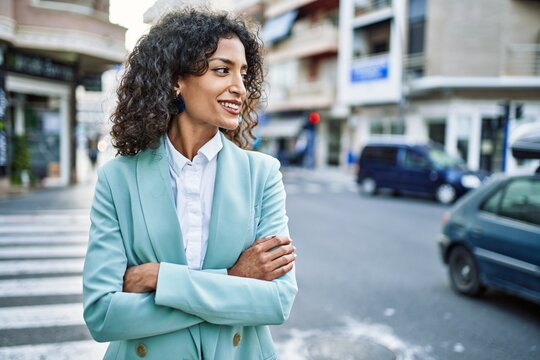 Young hispanic business woman wearing professional look smiling confident at the city