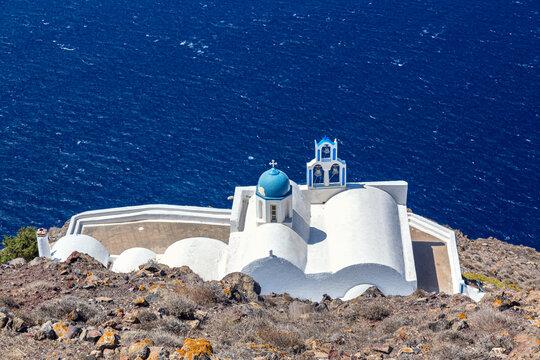 The Chapel of Panagia Theoskepasti with Aegean sea. Skaros rock, Imerovigli, Santorini island, Greece.