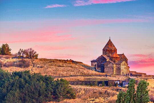 Ancient Sevanavank monastery on Lake Sevan in Armenia during sunset