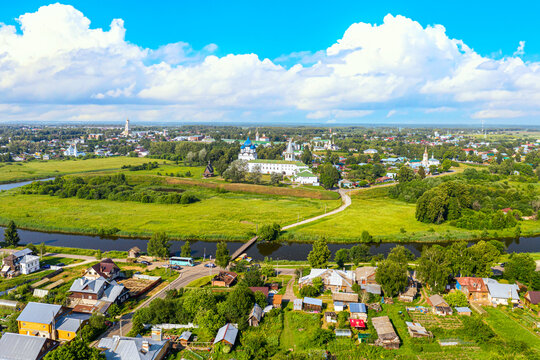 Aerial drone view of Suzdal Kremlin and cathedral of Nativity at the Kamenka river, Russia. Summer sunny day