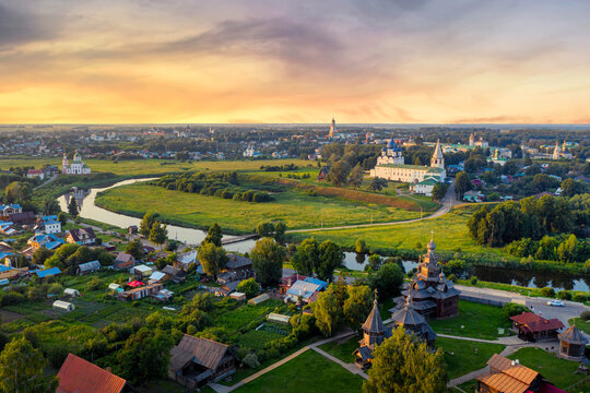 Aerial drone view of Suzdal Kremlin and cathedral of Nativity with Museum of Wooden Architecture at the Kamenka river, Russia. Summer sunny day sunset