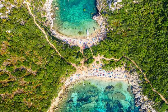 Corfu Island iconic image. Aerial drone view of Porto Timoni beach in Corfu. Ionian sea, Greece.