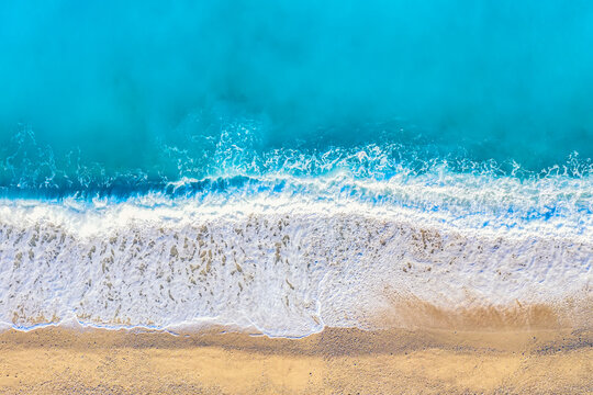 Top view aerial drone photo of Myrtos beach with beautiful turquoise water and sea waves. Vacation travel background. Ionian sea, Kefalonia Island, Greece