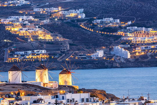 Iconic picture of Mykonos. Famous windmills of Mykonos Island, Greece. Sunset time