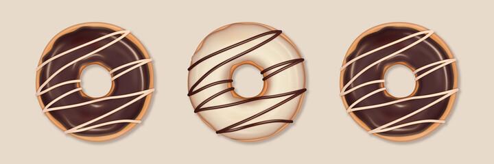 Obraz Trzy pączki na jasnym beżowym tle. Pyszne ciastka z czekoladową i waniliową polewą. Tło dla dla piekarni, cukierni, kawiarni, do social media, na menu, ulotki, plakat, kartki. - fototapety do salonu