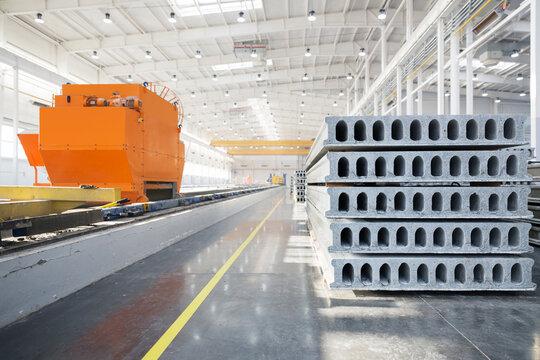 Stack of precast reinforced concrete slabs in factory workshop