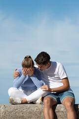 Obraz Teenage boy consoling his depressive girlfriend - fototapety do salonu