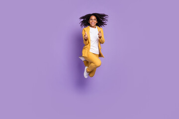 Obraz Photo of cheerful positive lady wear yellow suit glasses jumping high pointing fingers you isolated purple color background - fototapety do salonu