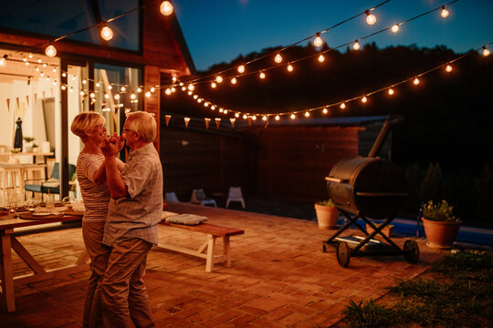 Happy senior couple dancing together outdoors