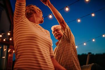 Obraz Senior couple laughing and having fun while dancing - fototapety do salonu
