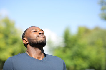 Man with black skin breathing in nature