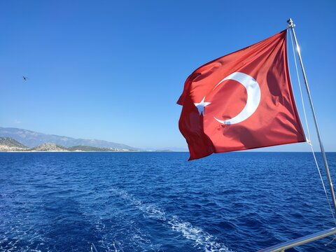 the Turkish flag is flying over the sea