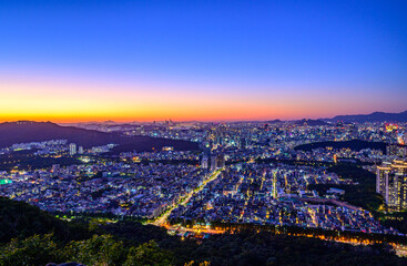 Seoul city night view from the top of the mountain at sunset time