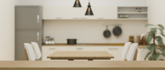 Obraz Empty space on wooden board for montage on blurred minimalist kitchen and dining room interior - fototapety do salonu