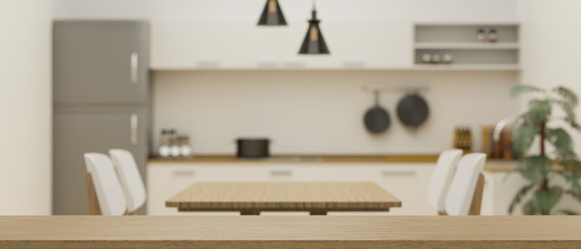Empty space on wooden board for montage on blurred minimalist kitchen and dining room interior