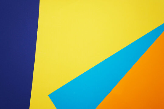 Abstract blue and yellow, dark blue and orange color paper geometry composition background. Geometric shapes and lines.