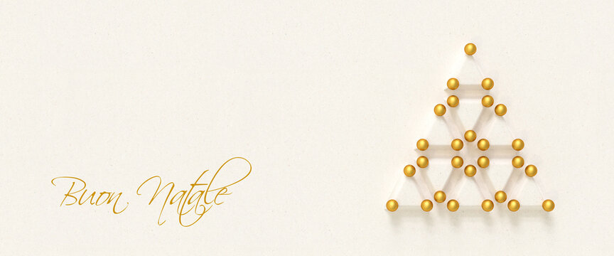 """Christmas tree made from paper triangles and golden baubles. Italian Message """"Buon Natale"""" (Merry Christmas) to the left. Web banner format. Copy space."""