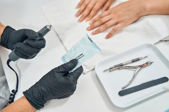 Close up of master preparing sterile instrument
