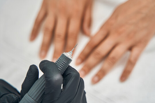 Close up of sterile instrument being in female hand