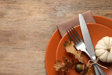 Obraz Festive table setting with autumn decor on wooden background, top view. Space for text - fototapety do salonu