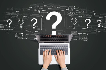 Obraz Question marks with person using a laptop computer - fototapety do salonu
