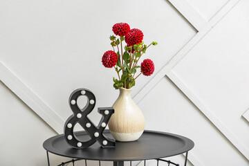 Obraz Vase with beautiful dahlia flowers on table - fototapety do salonu