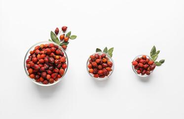 Obraz Bowls with fresh rose hip berries on white background - fototapety do salonu