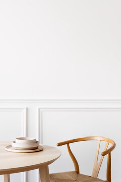 Clean and minimal dining room table with chair