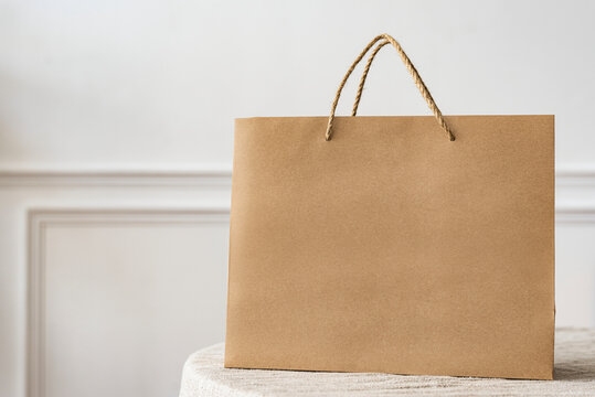 Paper shopping bag in a bright apartment