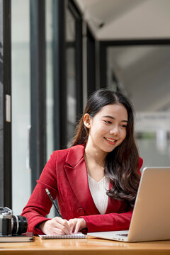 Beautiful asian working with happiness at office.