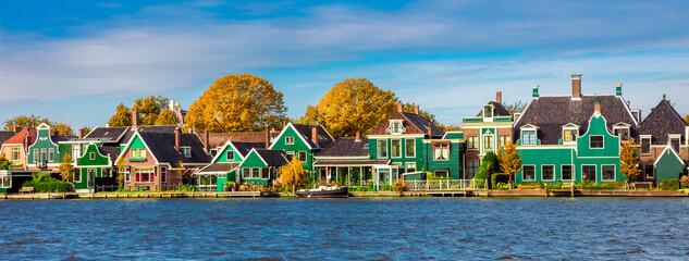 Obraz Dutch village Zaanse Schans near Amsterdam. Typical Dutch wooden green houses. Holland, Netherlands - fototapety do salonu