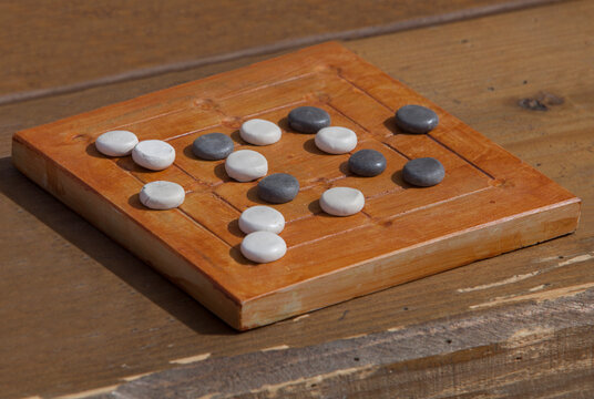 Reconstruction of roman board game Nine mens morris or mill game