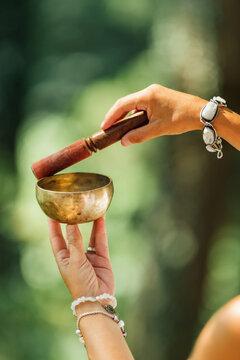 Woman Playing on Tibetan Singing Bowl