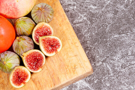 Closeup of figs on a cutting wood
