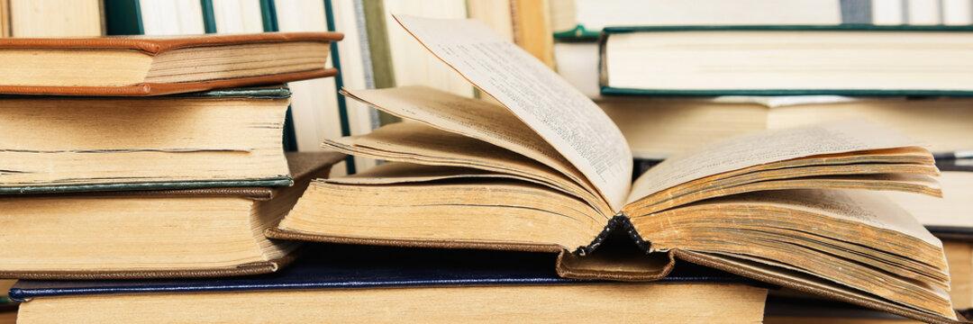 Close-up of hardback books and textbooks. Panoramic image.