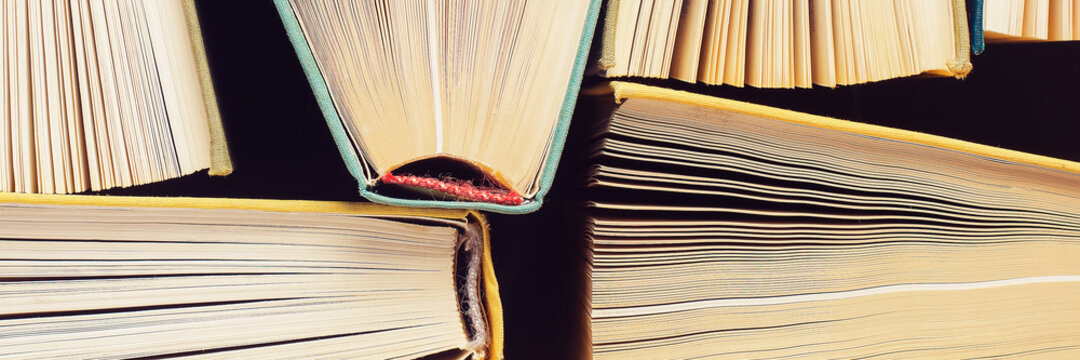Close-up of a hardback book. Panoramic image.