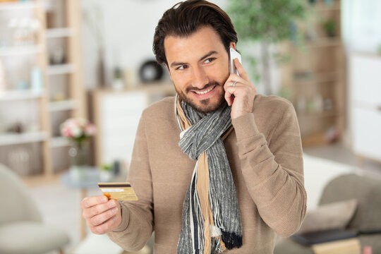 portrait of a cheerful man shopping online with credit card