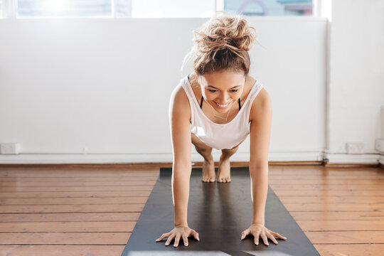 Bright pilates studio with girl doing a plank