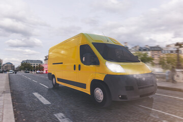 Obraz Transportation service with a yellow van moving fast on the road - fototapety do salonu