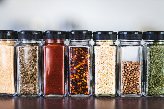 spices seeds and seasonings in mathing spice jars on tidy pantry shelf, simple vegan ingredients and flavoring your dishes