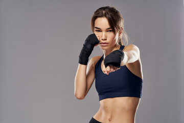 Obraz slender woman in boxing bandages workout fitness fighter studio gym - fototapety do salonu