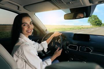 Obraz Beautiful young woman on driver's seat in modern car - fototapety do salonu