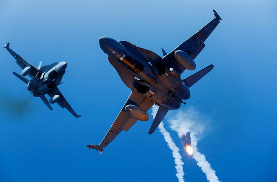 Two F-18 fighter aircrafts of the Spanish Air Force launch flares during the Ocean Sky 2021 Military Exercise for advanced air-to-air training in the southern airspace of the Canary Islands