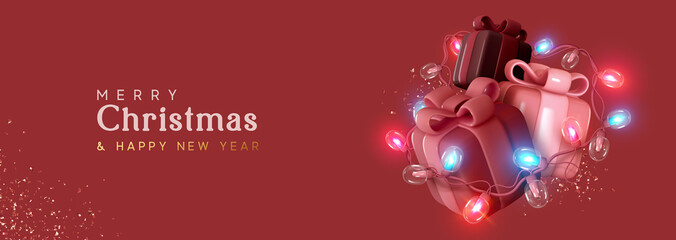 Obraz Christmas gift box. Presents with surprise, wrapped in bright light burning garland. Xmas festive background with realistic 3d design element. Happy New Year. Horizontal banner, header for website - fototapety do salonu